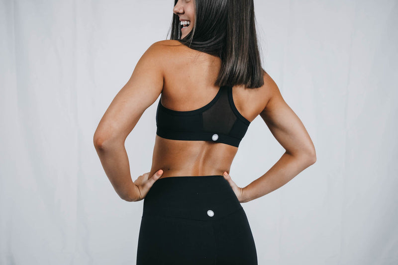 Charisma showing the back of the Small Black Everyday Bra