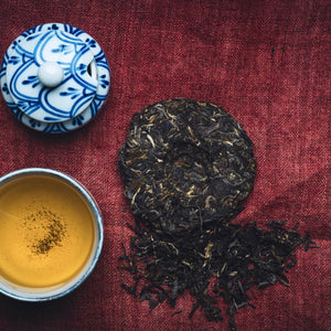 Shop online : 100g teacake - 2019 first grade raw (Sheng) pu-erh teacake from Bulang Moutain. Handcrafted in one of the most bio-diverse regions in Yunnan, Bulang teas are known to be distinctive with a certain bitterness and bold sweetness. Traditionally tone-pressed. Flavour profile: smoked wood, honey