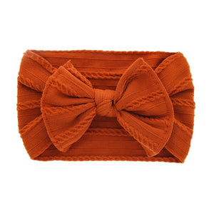 Cable knit bow in orange