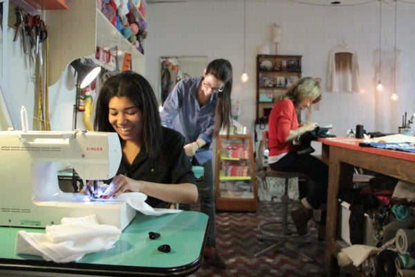 Nilina sews a panda scarf at a drop-in sew café in Paris.