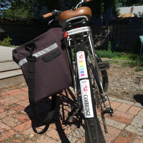 Barbara loves her panniers for storing bike essentials, and she also loves Boston!