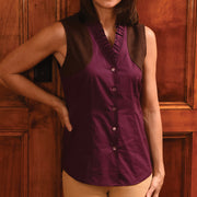 Model wearing a violet Kevin's Huntress Sleeveless Ruffle Shooting Blouse