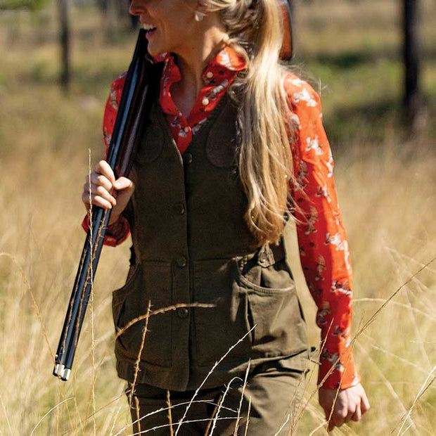 Hunter wearing Kevin's Huntress Field Vest during a quail hunt