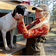 Female hunter petting bird dog after a quail hunt