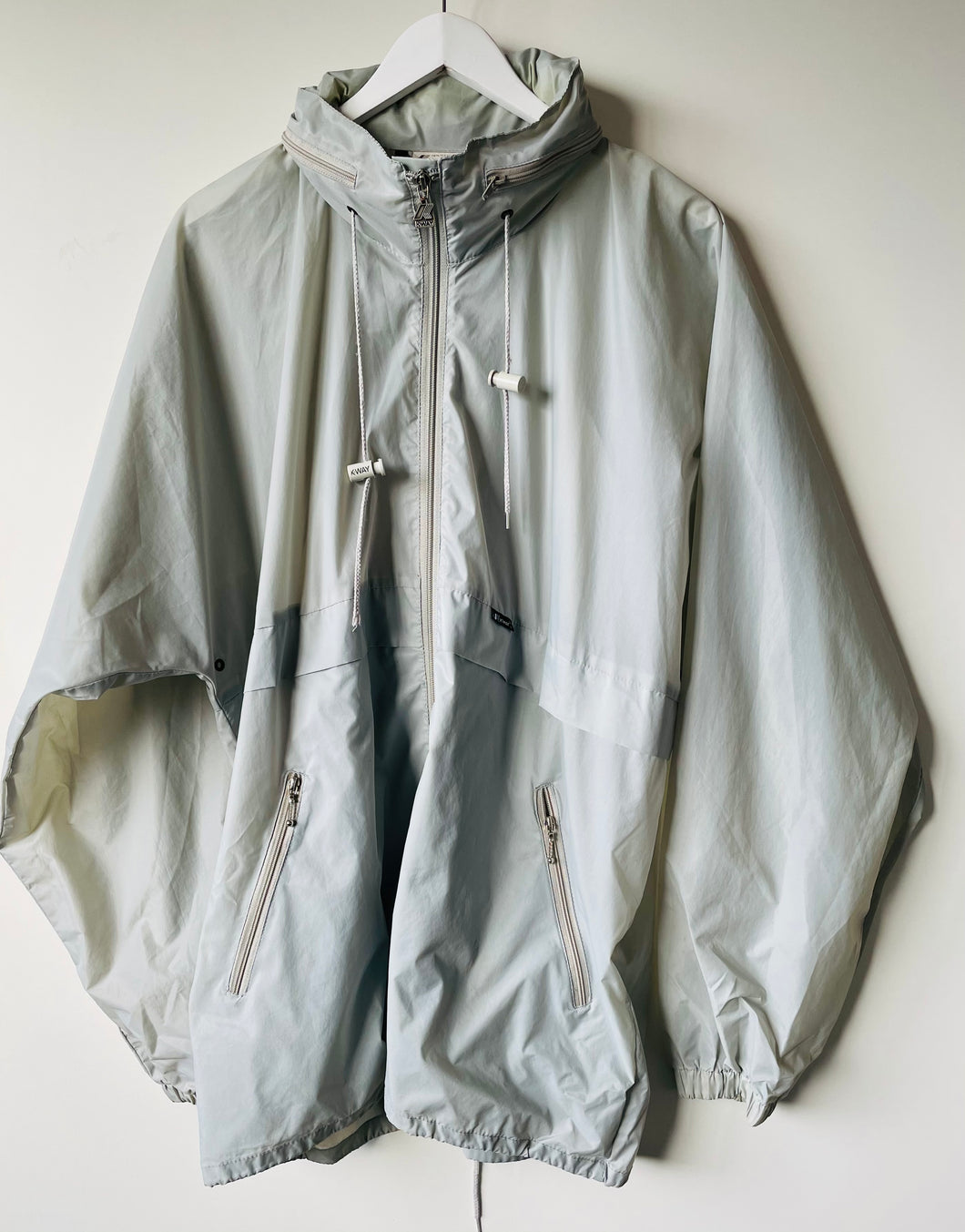 Grey K-Way rain jacket