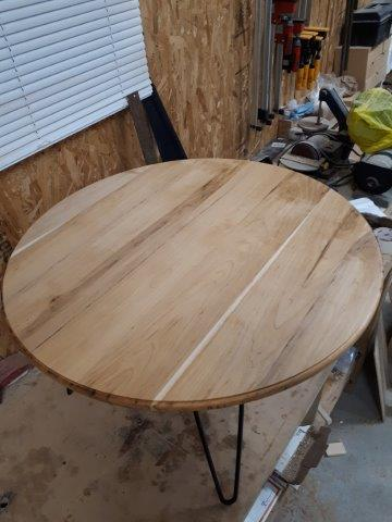 Round coffee table from Brown Maple