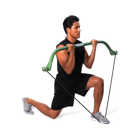 a man pairs lunges with resistance band training