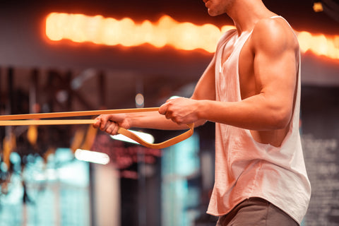 man doing resistance band workout