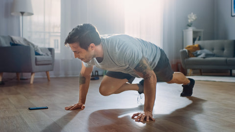 man doing hiit workout at home