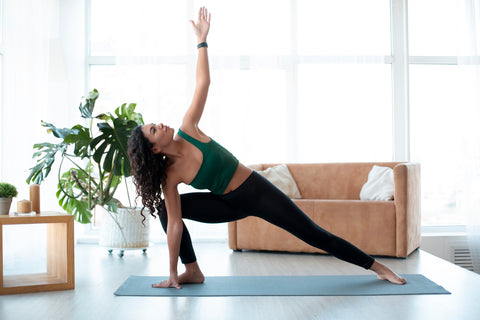 woman doing yoga indoor exercise