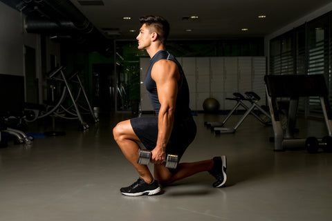 Man exercising lunges with weights