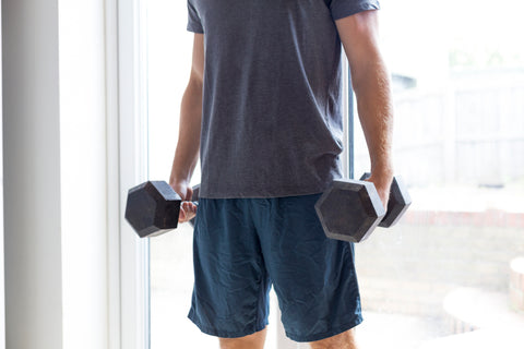 man holding weights for workout