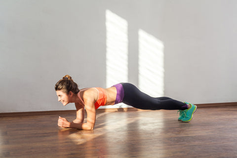 woman holds a plank for resistance training