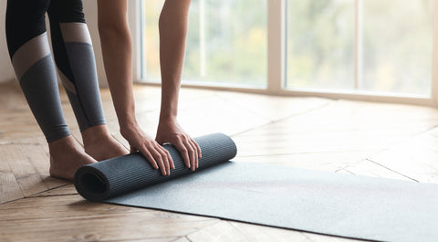 woman uses yoga mat in her home gym