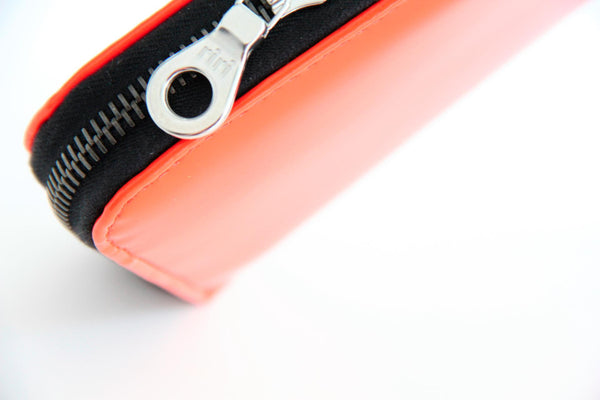 Victor Simoni Arancina Orange Gloss Wallet features a durable black metallic zipper, imported from RIRI in Switzerland