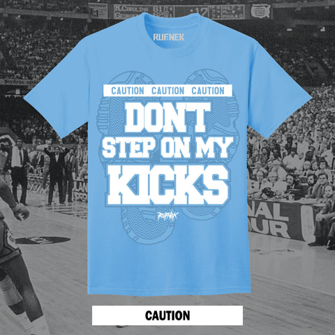 CAUTION (UNC BLUE SHIRT)