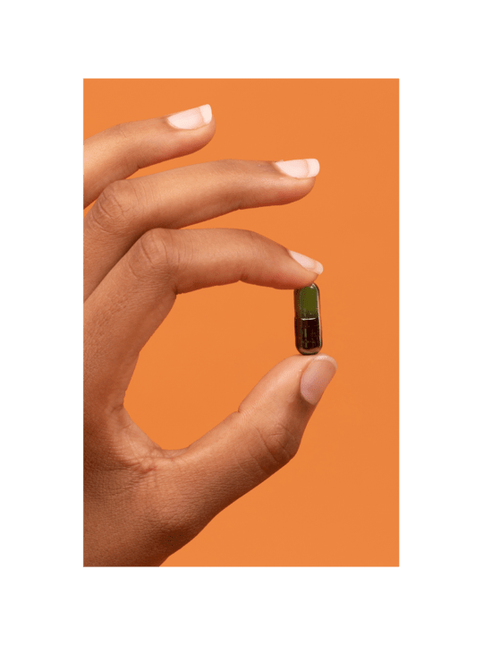 Woman Holding Pill With 9 Vegan Nutrients