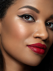 Perfect cat eyeliner makeup Heaux Cosmetics black female model red lips escort