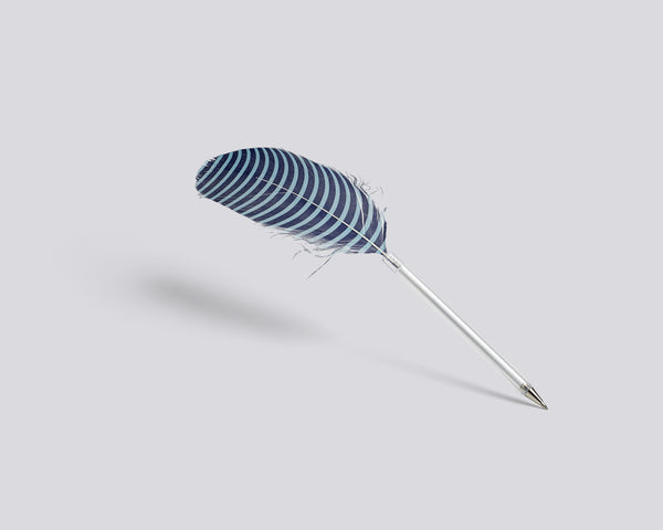 Feather pen with blue circles by HAY
