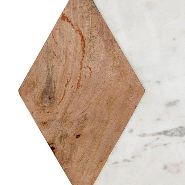 Close up image of hexagonal chopping board in marble with wood insert by Hubsch