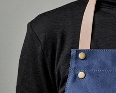 Apron in organic cotton blue by ferm LIVING