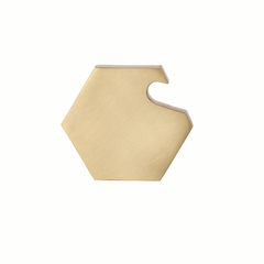 Hexagonal brass bottle opener by ferm LIVING