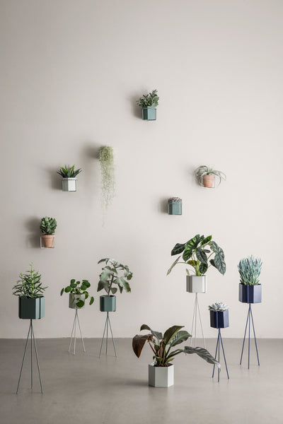 Context image of small grey plant stand by ferm living