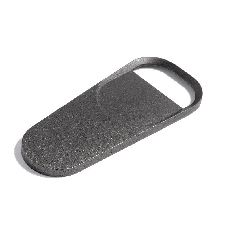 Product shot of Anthracite bottle opener by HAY