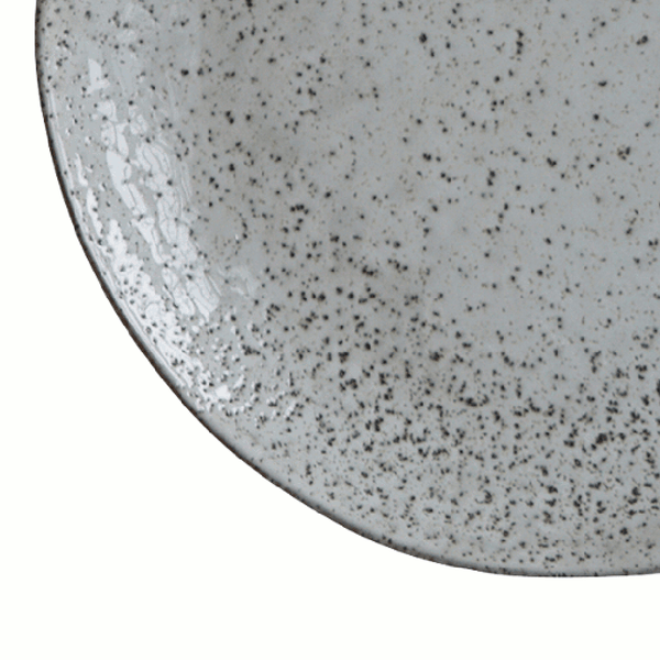 Close up image of grey rustic dinner plate by house doctor