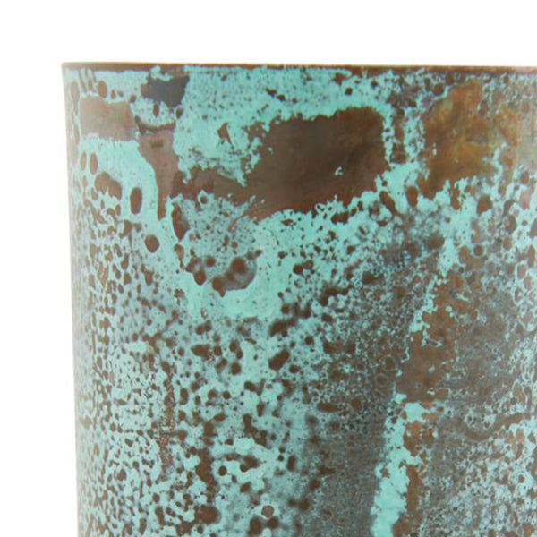 Close up Image of metal green vase by house doctor