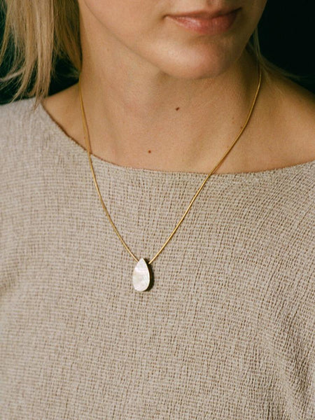 Raindrop necklace in brass by Wolf & Moon