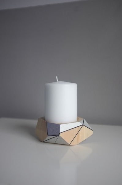 Candle holder (with tall candle) by Polymorphics