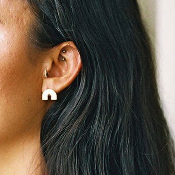 Image of curve earrings on a model