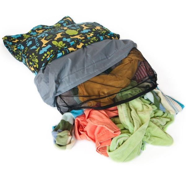 Stuff old clothes and blankets into a stuff sack
