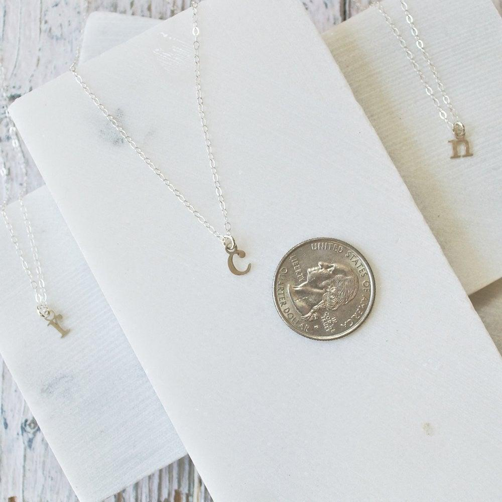Sterling silver tiny initial charm necklaces sterling silver tiny initial charm necklaces uni t aloadofball Images