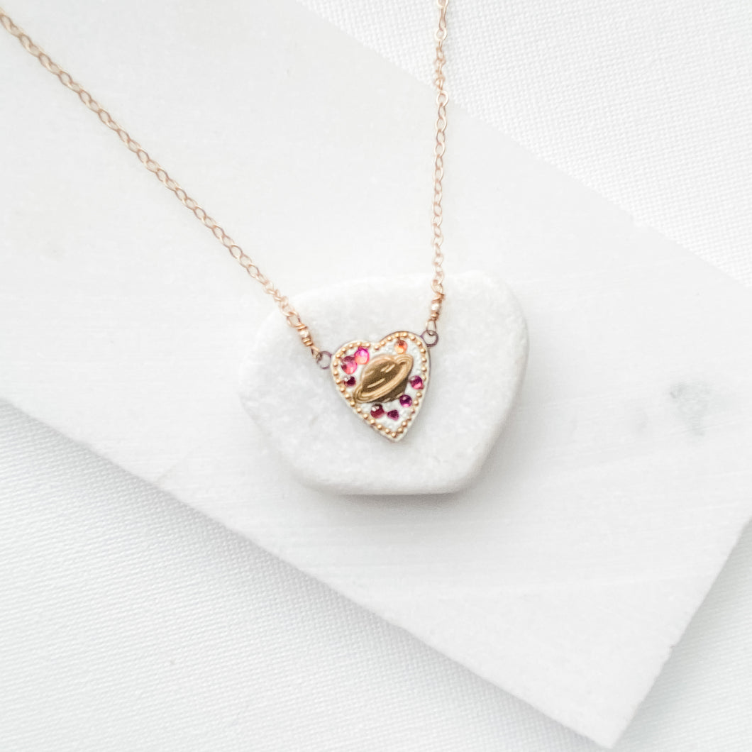 Tiny Saturn on a heart necklace