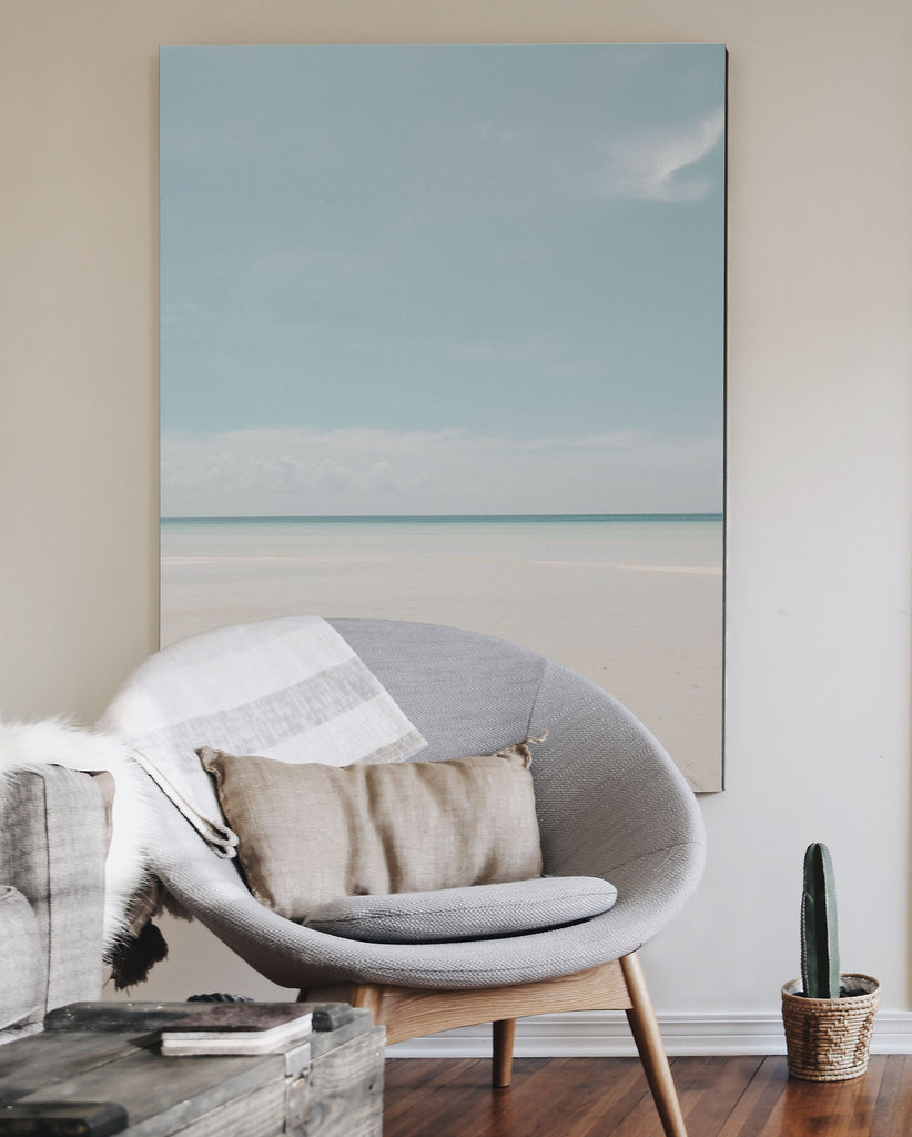 light blue beach and white sand with dark blue ocean photo art print extra large in living room