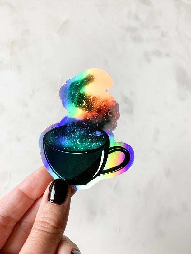 coffee cup with space pattern in steam on holographic sticker