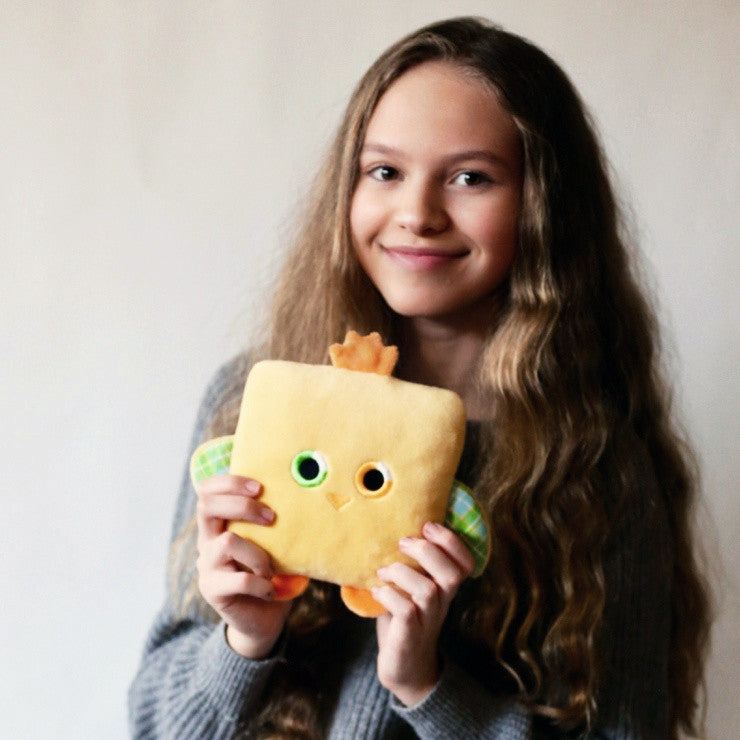 Plush toy chick stuffed animal bird with a useful back pocket, designed by young entrepreneurs