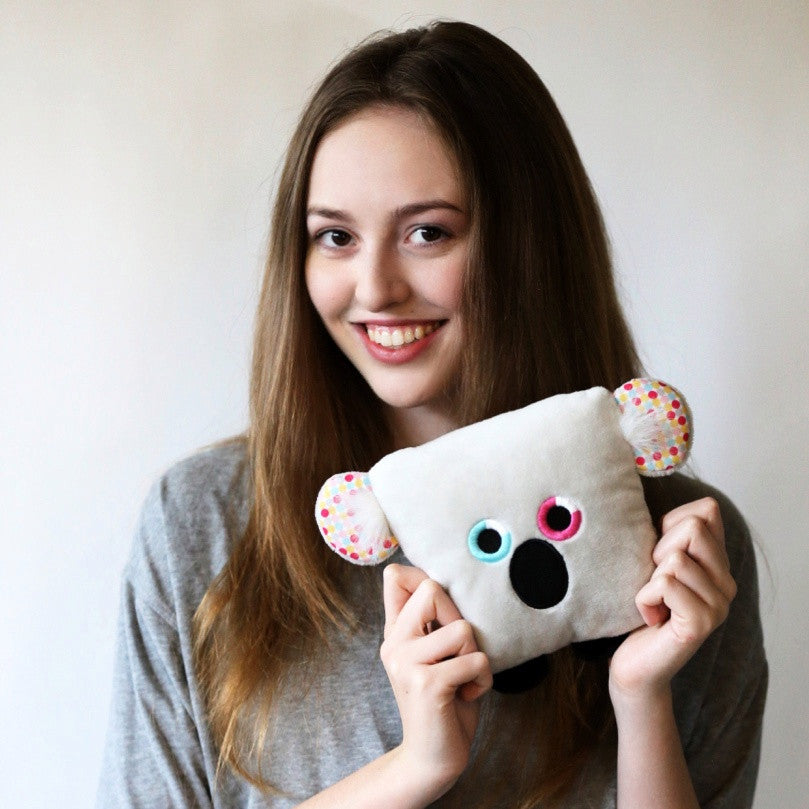 Plush toy koala bear stuffed animal with a useful back pocket, designed by young entrepreneurs