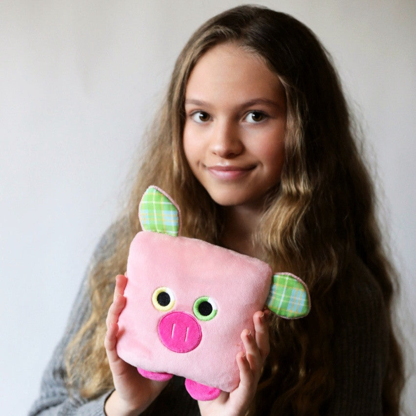 Plush toy pig stuffed animal with a useful back pocket, designed by young entrepreneurs