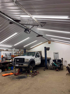 Work Shop Garage with truck being fixed under NuGen LED Solutions 8FT Linkable Integrated Lights Strips