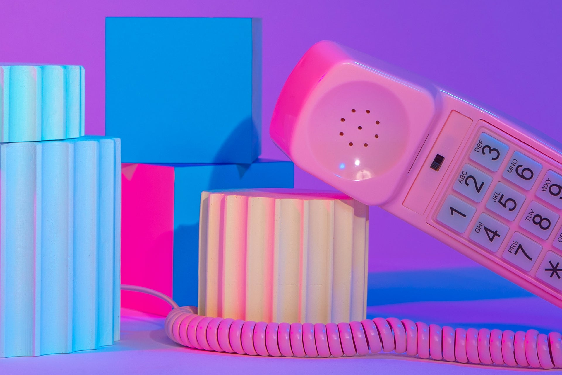 Multi-color background with pink phone | Kinship