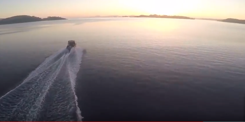 Splash Drone Chasing Boat at Speed