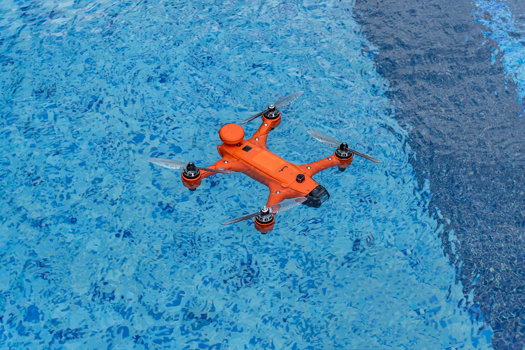 swellpro spry plus drone floating on water