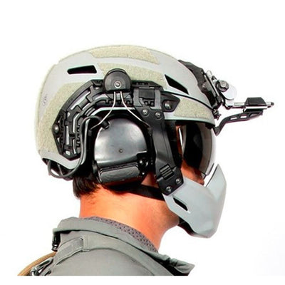 Galvion Batlskin Caiman NVG Arm Visor with Smoke Lens in use with Caiman Hybrid Helmet and Caiman Bump Mandible Guard