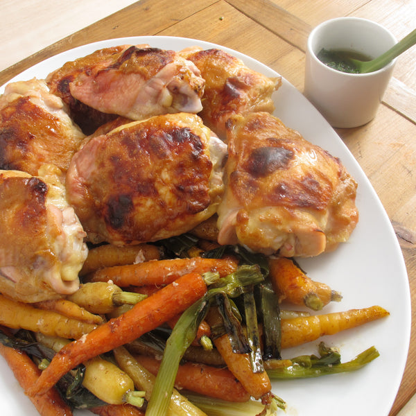 Glazed chicken thighs with baby carrots mint pesto tessemaes what makes this recipe even better is that putting the chicken right on the veggies means they literally baste in juicy juices while they cook whoa yeah forumfinder Image collections