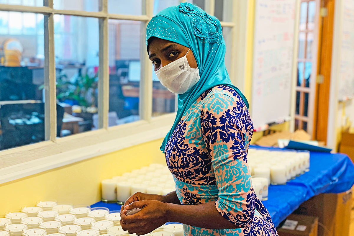 Nyota, Congolese candle-maker at Prosperity Candle, resettled to the U.S.