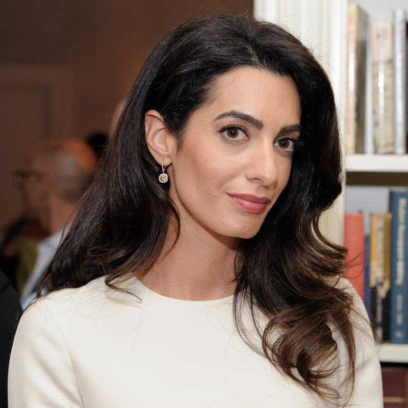 Human rights lawyer Amal Clooney i is an inspiration to Prosperity Candle's women refugees pouring fair trade handmade soy candles
