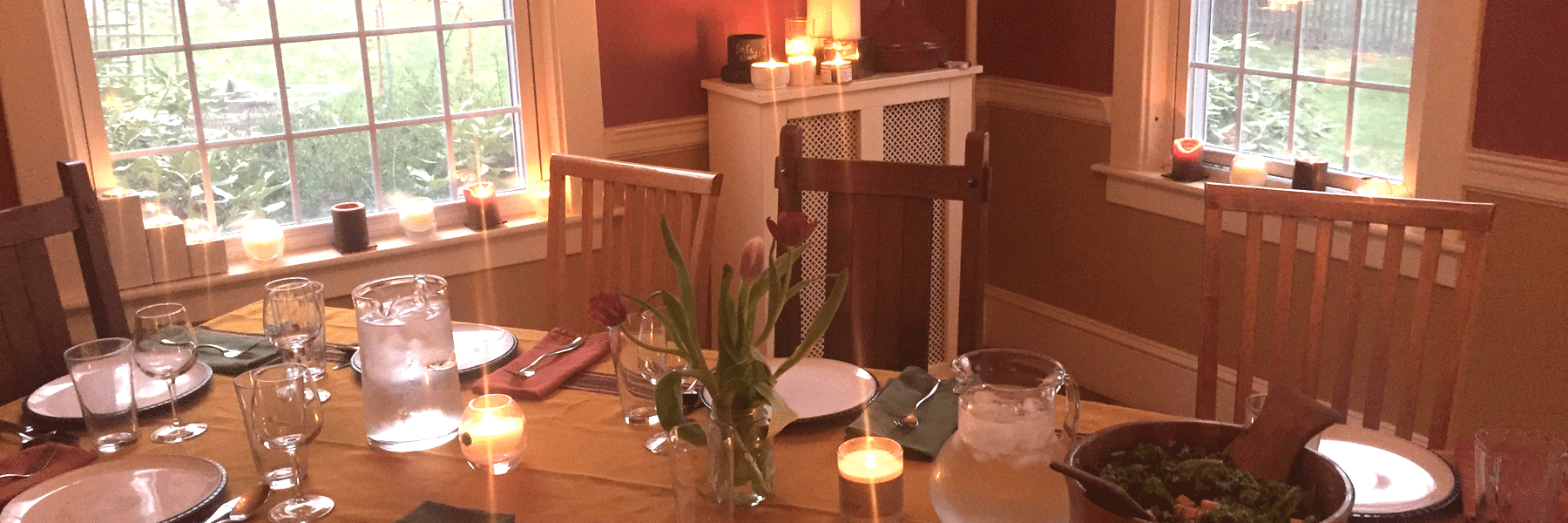 Fair trade candles lit in dining room handmade by Propserity Candle's women artisans